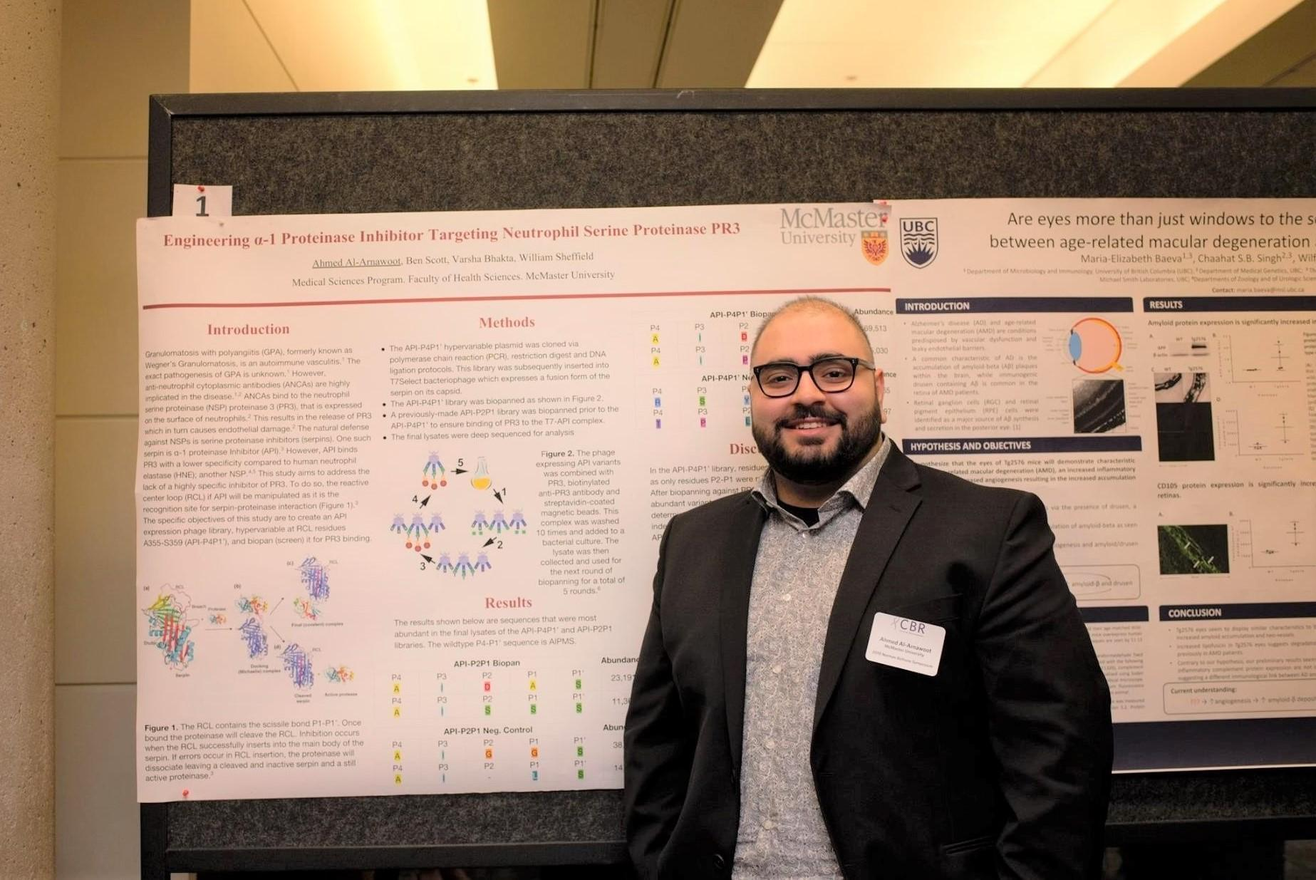 Ahmed Al-Arnawoot with his poster presentation