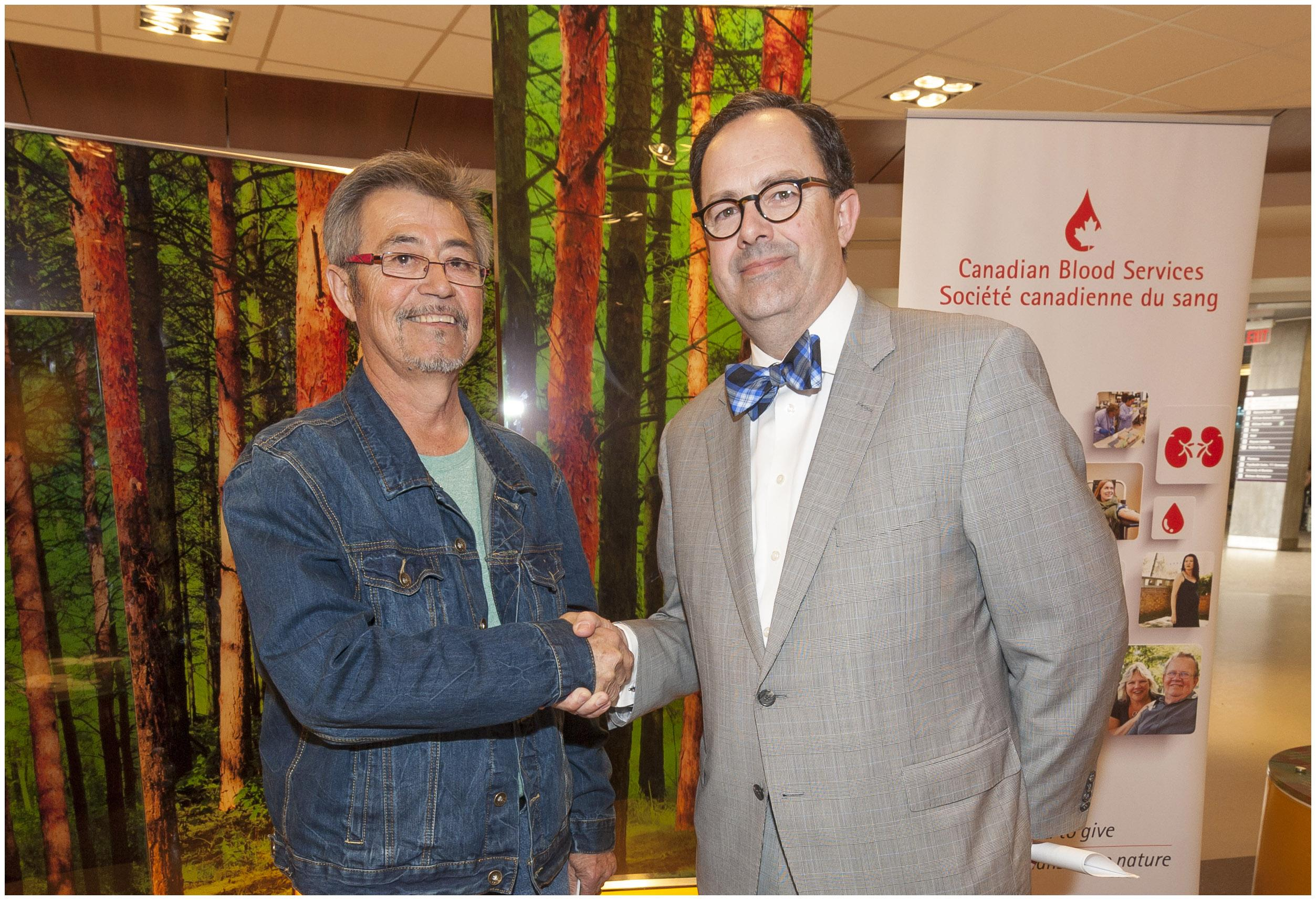 Arnold Dysart (left) pictured with Dr. Peter Nickerson (right), Medical Advisor, Organ Donation and Transplantation Division, Canadian Blood Services. Arnold received his kidney in 2014