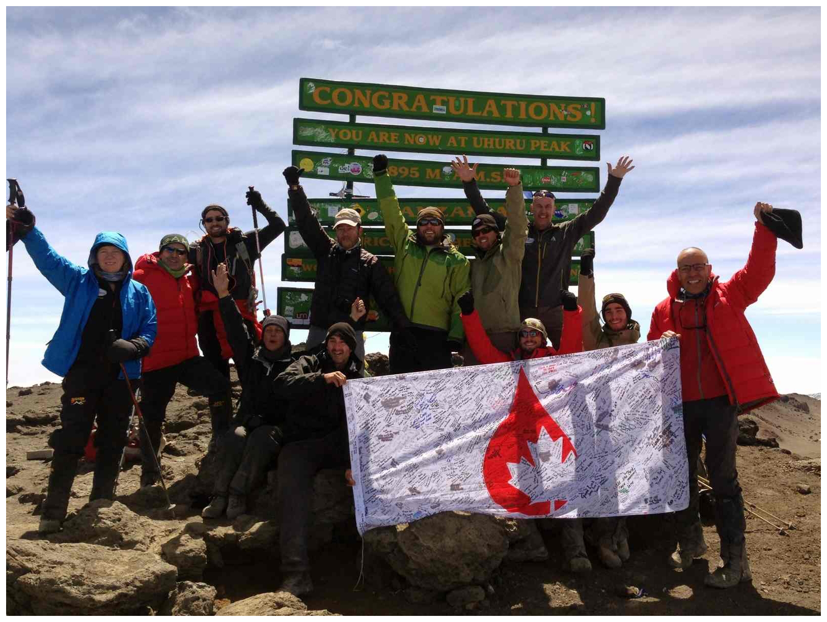 The climb team celebrates their trek at Mount Kilimanjaro