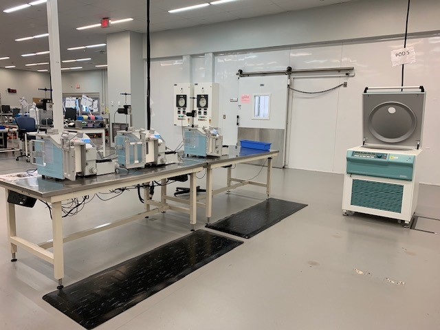 three units shown on left of photo) and centrifuge (on the right) in the Canadian Blood Services manufacturing site in Brampton, ON