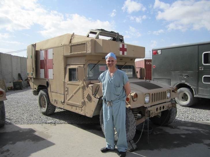 Dr. Andrew Beckett at Kandahar Airfield in front of Humvee ambulance