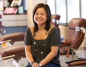 Smiling woman sitting in a Blood Donor Clinic