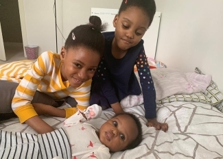 Red blood cells recipient Aaliyah Mchopanga with her sisters Naila and Mya
