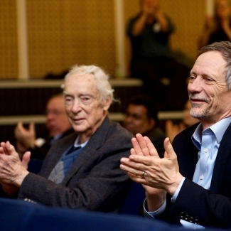 Dr. Earl W. Davie (left) enjoying presentations at the 13th annual Earl W. Davie Symposium in Vancouver.