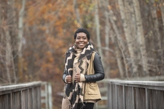 Revée Agyepong smiling and standing outdoors