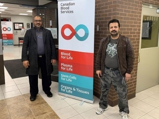 Mohammad Alawi, right, was recruited by longtime Canadian Blood Services volunteer Abdelsalam Abugharara, left, to give blood April 2, 2020.