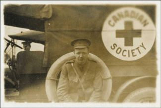 L. Bruce Robertson beside Canadian Red Cross truck, ca. [1914-1918]  Copyright: Queen's Printer for Ontario