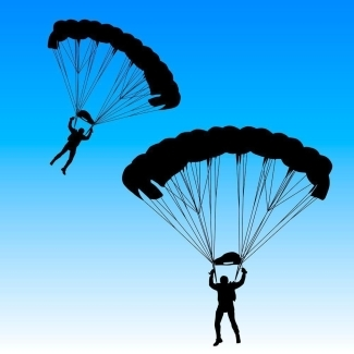 Image of two parachuters jumping at night