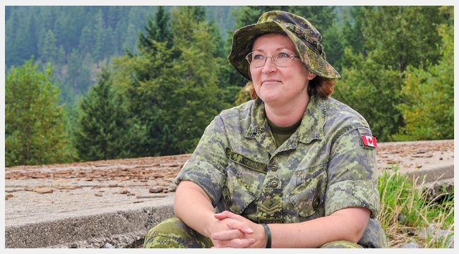 Image of blood donor Corporal Laura Matern sitting on a rock wearing full military uniform